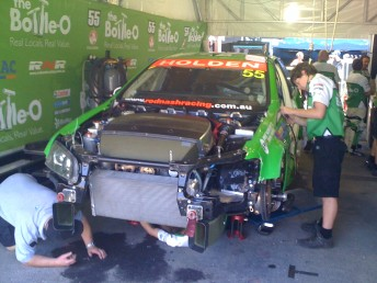 D'Alberto's car gets repaired after hitting the wall at the Nikon SuperGP