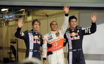 Vettel, Hamilton and Webber celebrate their top three grid places at Abu Dhabi
