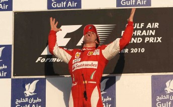 Fernando Alonso celebrates on the Bahrain podium