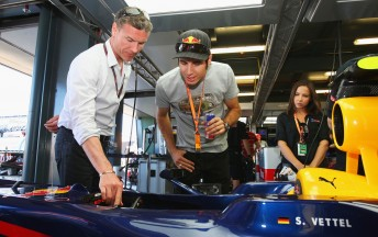 David Coulthard guides Red Bull-supported driver Rick Kelly through Sebastian Vettel's F1 car at last year's Australian Grand Prix