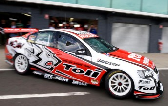 James Courtney peels out of the pit garage at The Island yesterday