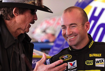 Marcos Ambrose shares a laugh with team owner Richard Petty at Daytona