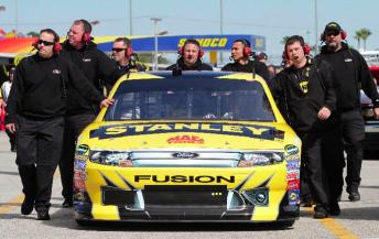 Ambrose's crew push the RPM Fusion through the garage area