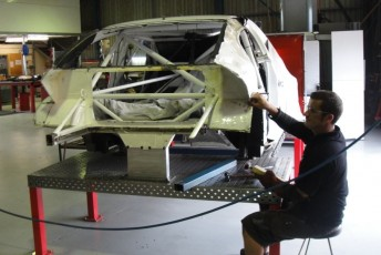 Jason Barwanna's Commodore being worked on at the BJR team's Albury base
