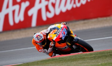 Stoner takes MotoGP title lead with win