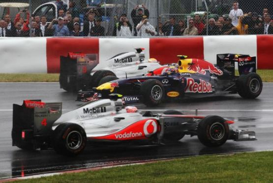 Button downs Vettel in final lap thriller