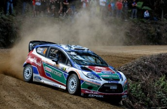 Ford in command after eight stages