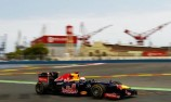 Vettel scores pole on mixed afternoon for Red Bull