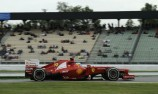 Fernando Alonso on pole at wet Hockenheim