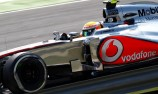 Hamilton resists Lotus charge for Hungarian GP win