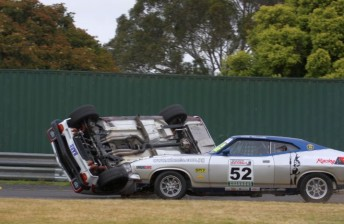 Tony Edwards' Torana turns turtle after a hit from Keith Kassulke