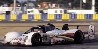 Brabham took the checkered flag in the Peugeot 905 to win the 1993 Le Mans 24-hour