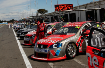 The V8 Supercars field await qualifying in pit lane at Winton