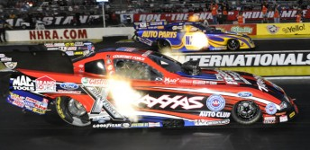 Courtney Force (near lane) blasts off in the Winternationals final against Ron Capps (PIC: NHRA.com)