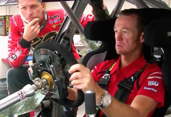 Greg Murphy tries on Garth Tander's HRT Commodore for size