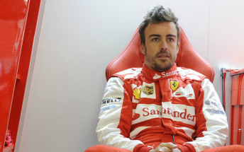 Fernando Alonso gathers his thoughts between on track stints