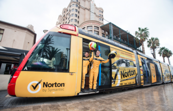 James Moffat and Michael Caruso with the yellow Norton tram
