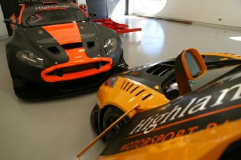 Inside the museum. an Aston Martin sits beside the McLaren MP4-12C
