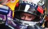 Sebastian Vettel claims pole at Sepang in rain-hit qualifying