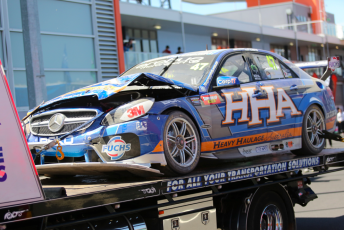 The Slade/Thompson Mercedes is returned to pitlane