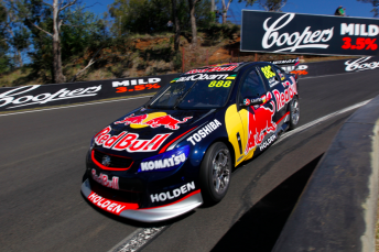 The #888 Red Bull Triple Eight Holden plunges through The Dipper