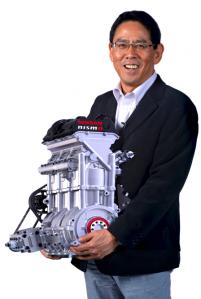Nismo president Shoichi Miyatani with the three-cylinder engine