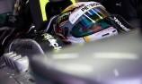 Hamilton tames wet Sepang to claim pole