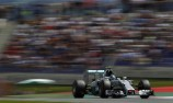 Rosberg holds off charging Hamilton in Austria
