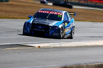 Paul Dumbrell boosted his title hopes with victory in chaotic Queensland Raceway opener