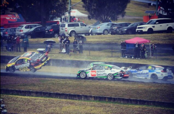 Slade's Holden took flight after clipping the stranded Reynolds