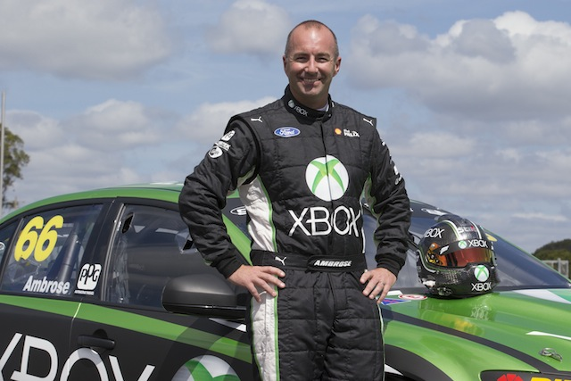 The suit Marcos Ambrose wore for his return to V8 Supercars following his nine-year NASCAR is being auctioned for charity on Speedcafe.com Classifieds