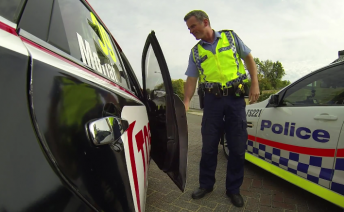 The car's onboard camera capturing the unexpected police attention