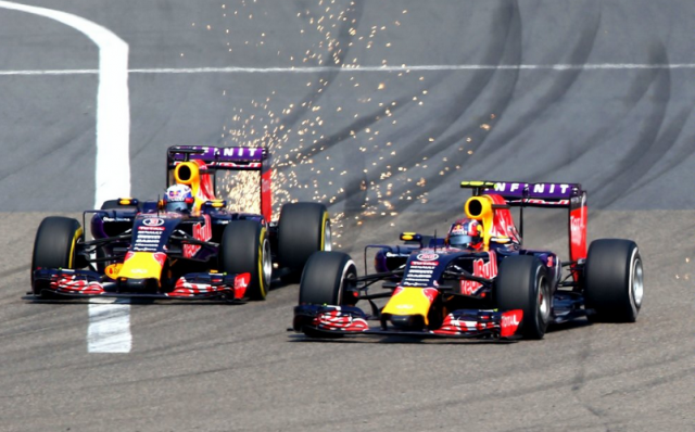 Sparks fly as Ricciardo attempts to pass Kvyat during the Chinese Grand Prix