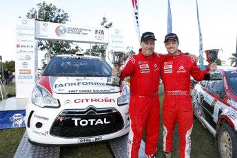 Eli Evans (right) with co-driver Glen Weston at the in Queensland