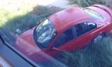 Car crashes into V8 Supercar Headquarters