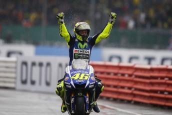 Valentino Rossi celebrates victory in British Grand Prix which saw him regain the lead of the championship.