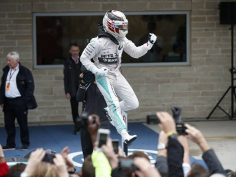 Lewis Hamilton celebrates third world title