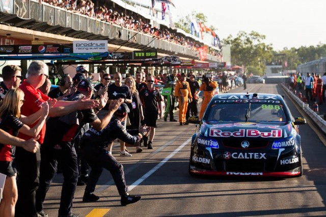 The pitlane applauds Craig Lowndes after his 100th career win