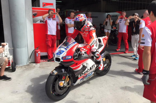 Casey Stoner aboard the GP15, complete with his famous #27