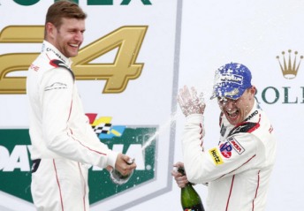 Bamber (right) celebrates with co-driver Daniel Christensen