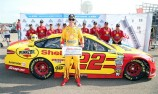 Logano takes Michigan pole