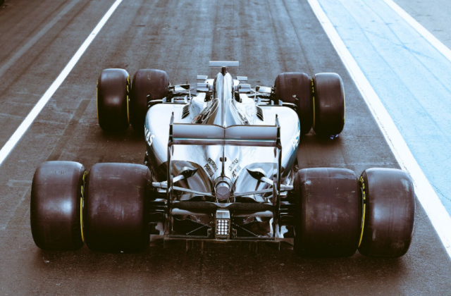 Wider rubber and increased downforce will lower lap times