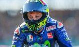 Rossi back on bike in bid for early return