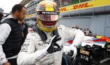 Hamilton takes pole record in delayed qualifying