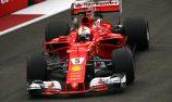 Vettel denies Verstappen pole in Singapore