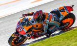 Marquez wins MotoGP title despite near-crash