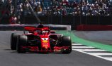 Vettel triumphs after four-way British GP scrap