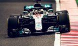 Hamilton scores pole in Japan as Vettel falters