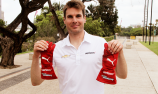 Will Power hands over signed Indy 500 gloves to Speedcafe.com winner