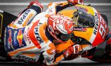 Marquez on pole despite crashing at wet Sepang